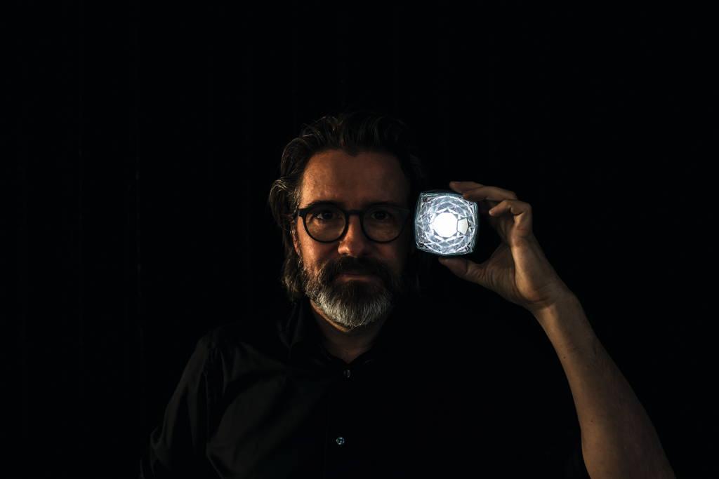 02_Olafur Eliasson with Little Sun Diamond_credit Studio Olafur Eliasson