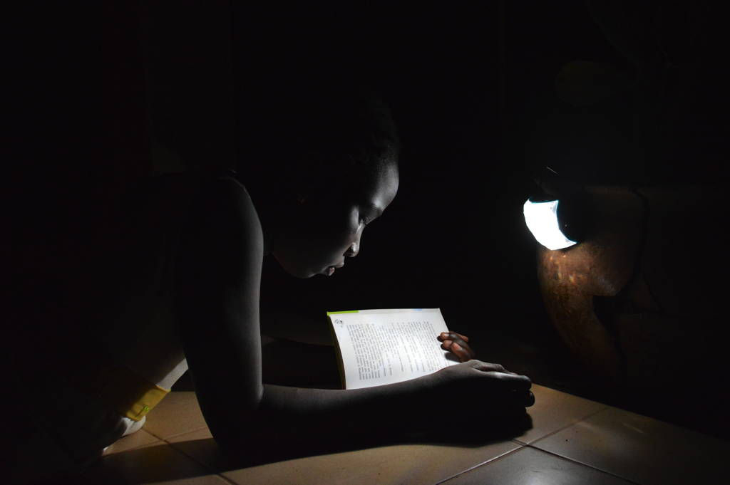 Little Sun Diamond in Senegal_kids reading_credit Little Sun